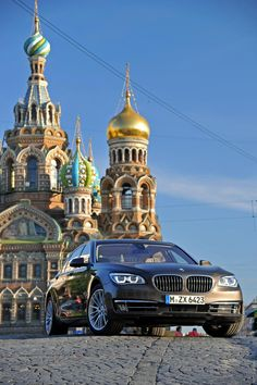 2013 BMW 7 Series, such a HOT car! Plus I love the way cool building it's driving away from.