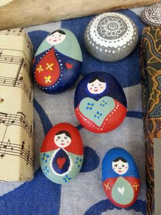 Russian doll painted pebbles