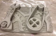 GCSE Y10 bas relief clay slab experiment for Portfolio Project 2. St Mary's Catholic High School