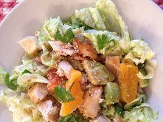 Fresh grilled chicken with oranges, avocados over a bed of Napa cabbage with a peanut sesame lime dressing.