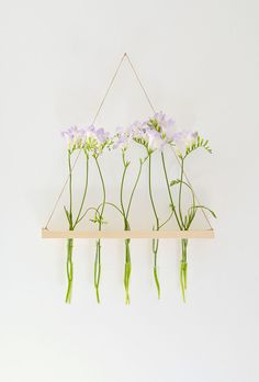 This hanging flower display will brighten any room in your home.
