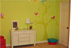 What about free-handing this tree in white on a yellow wall? And later pinning Charlee's artwork to make it look like it's hanging from the branches? Super easy, and super cute!