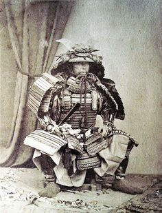 "Samurai from ""Young Japan. Yokohama and Yedo. A Narrative of the Settlement and the City from the Signing of the Treaties in 1858, to the Close of the Year 1879"" by John Reddie Black (1826-1880), born in Scotland but lived most of his life in China and Japan he published many newspapers and journals, The Far East (1870) is appreciated in particular because it used original photographs. Black was a photographer, he employed both English and Japanese photographers he also published his own…"