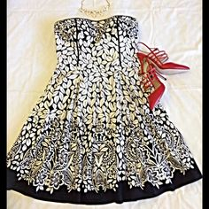 """WHBM Strapless Dress Beautiful mostly cotton with a little spandex (3%) and cotton lining. Floral pattern stands out on the black background. Bust is 36"""", waist is 33"""" and length is 32"""". Has belt loops at sides but no belt. You could add a pretty belt or remove the loops entirely as this dress can stand alone. White House Black Market Dresses Midi"""