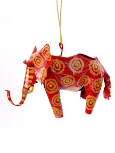 """Elephant Ornament. The elephant signifies strength, royalty, dignity, patience, wisdom, longevity, and happiness. Highly revered for its intelligence, the elephant also has a strong sense of loyalty and community. A powerful symbol of good fortune, keeping a lucky elephant in your home is thought to protect you from bad luck and stimulate prosperity in your life.    Height: 2.75""""  Length: 4""""  Width: 2""""  Artist: Daniel Thomas, painted by Khumbalani  Made In: Zimbabwe  $12.00"""