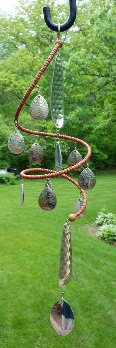 Item 168- Wood & silvertone fishing lure suncatcher/mobile.  Sold!