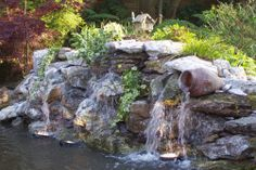nice stacked flagstone waterfall idea for the pond