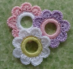 Flower_2_re_small ,crocheted in a plastic ring..this is a great idea to use in jewelry making! There is a free pattern for this and other plastic ring designs here!!
