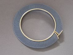 Danish artist Hanne Behrens I A student of Arline Fisch and Mary Lee Hu I  In 2000 she was commissioned to make a brooch as a gift to Queen Margrethe of Denmark on her 60th birthday.