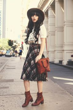 love the plaid skirt and boots combination