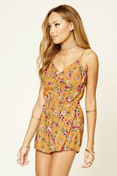 A sleeveless woven romper featuring an allover floral print, cutout back with self-tie straps,  V-neckline, adjustable straps, and an elasticized waist.