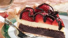 Pillsbury® refrigerated pie crusts provide a simple addition to this luscious strawberry fudge dessert layered with brownie and cheesecake – a lavish treat.