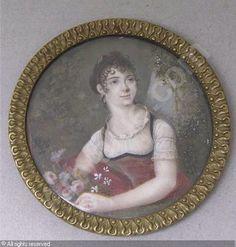 FRENCH SCHOOL - Femme à la robe rouge tenant des fleurs dans un paysage arboré