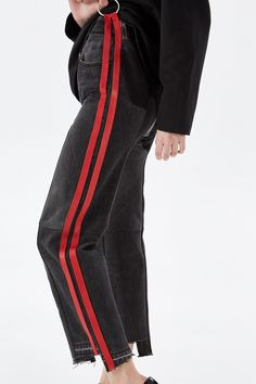 """<p style=""""text-align: justify;""""> Vetements breaks all the boundaries in fashion with its coolest pieces. These black jeans has asymmetric raw edges and red stripes. Wear them with <a href=""""/catalog/product/75415/"""">T-shirt from the same collection</a> and <a href=""""http://en.km20.ru/catalog/product/75407/"""">heeled an..."""