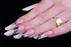 Long almond shaped french nails, made with uv gels, and decorated with painted roses