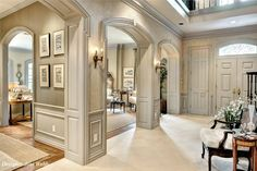 Lovely entry way however no carpet! Surely a woman did not design that white carpet in the foyer!