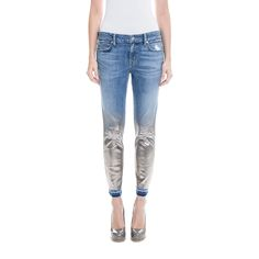 This season's biggest trend: Holographic, Metallic Foil on denim! We dress up and modernized our Amber skinny with a luster & sheen applied to the bottom of the legs. Finished off with knee rips and a release bottom hem.