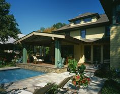 I like how the pool comes right up to the covered back porch - perfect for a small yard.