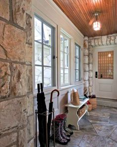 Enclosed breezeway mudroom cute bench and umbrella stand by kitchen entrance may look cute even use wicker baskets Enclosed breezeway mudroom … – Mudroom House With Porch, My House, Garage Addition, Enclosed Porches, Building A Porch, Breezeway, Stone Flooring, Stone Walls, Entry Hall