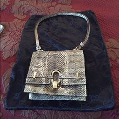 """Price Cut  Authentic Gucci Python Bag Authentic gorgeous Gucci Handbag Features Genuine Python. Magnetic closure with Gucci clasp very tiny scratch on clasp. Approximate 9.5"""" double drop strap. Chocolate Brown leather interior clean very tiny scratch barely noticeable, no stains, tears, or odors with inside zip pocket. Verification number14890165. Includes original Gucci dust cover. Final Sale No Trades Gucci Bags Shoulder Bags"""