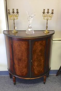 Mahogany Demi Lune Console with book-matched veneer panels and top, turned legs and bronze ormolu. Early 20th C. 30 x 15 x 32 tall. $495.00