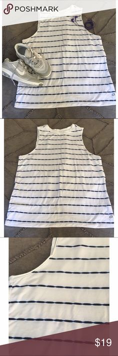 GAPfit Striped Muscle Tank White tank with blue tie-dye like stripes. The material is INCREDIBLY soft and stretchy. Worn once! Please feel free to make me an offer or request a bundle! I'm cleaning out my closet so all reasonable offers are considered 😊  🎁 Please no trades or PayPal! 🎁 GAP Tops Tank Tops