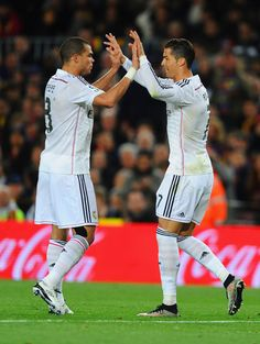 Cristiano Ronaldo of Real Madrid CF (R) celebrates with Pepe (L) as he scores their first and equalising goal during the La Liga match between FC Barcelona and Real Madrid CF at Camp Nou on March 22, 2015 in Barcelona, Catalonia.