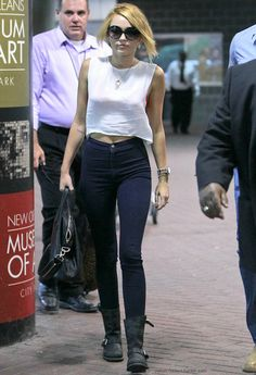 Miley always seems to know how to wear boots with jeans #fashion*inspiration(:  #bullheadblack if you want to rock jeans like miley!