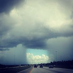 Clouds split, after rainfall in Florida. Amazing pic