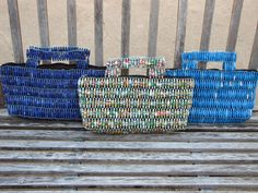 Beautiful bags, handmade in Uganda. Made with recycled magazine paper, these bags are a real eye catcher!     Zipper closure.    9 high at handle, 13 wide    Your purchase not only helps to provide for the women in Uganda but also helps to fund international adoptions from Uganda.