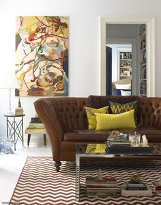 Brown leather couch - campaign table +modern art