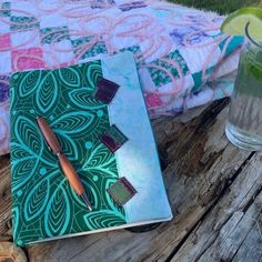 We're cooling down the summer with this custom tonal journal cover! Featuring a classic couching project in the back 🌸   #couching #quilting #quilt #summervibes #cooltones #cool #custom #diy #diyprojects #localbusiness #smallbusiness #inspiration