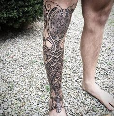 Runes, knots, dragons, wolves, snakes, godmasks, dots, sweat and blood. Tattoo Artist: Sean Parry