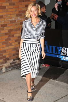10 slimming outfit ideas and styling tricks to try now: mixing stripe patterns as seen on Sienna Miller (asymmetrical stripes are most flattering)