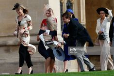 A guest bends down to collect her hat that blew off in the windy conditions as she arrives ahead of the wedding of Princess Eugenie of York to Jack Brooksbank at Windsor Castle on October 2018 in. Get premium, high resolution news photos at Getty Images Adele, Kate Middleton Skirt, Princess Eugenie And Beatrice, Gentleman, Eugenie Wedding, Windy Skirts, Eugenie Of York, Wedding Hats, Royal Weddings