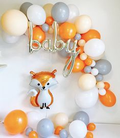 Our Balloon Garland Kit is absolutely perfect for your Fox themed baby shower or any occasion! Set contains: Orange, white, creme and gray baby shower balloons with baby script and fox balloon!