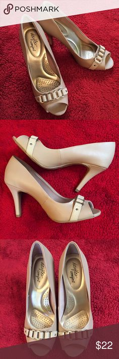 Classic NUDE Peep toe heels!! Perfect for the day at the office or a night out! • CLASSIC NUDE HEELS! • NWOT! • Size: 9 • Cute buckle adornment • 2 layer Memory Foam insole for support! • Flexible outsole • Round, open toe! • 4 inch heel! • Does have small, white mark above one heel; Bought it like that • Does not come w/ original box • DexFlex Comfort brand ❌PRICE FIRM❌❌ Dexflex Comfort  Shoes Heels
