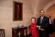 President Barack Obama and former First Lady Nancy Reagan walk side-by-side through Center Hall in the White House, June 2, 2009. To the left of Mrs. Reagan hangs her official White House portrait as First Lady. (Official White House Photo by Pete Souza)