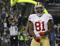 FILE - In this Jan. 19, 2014 file photo, San Francisco 49ers' Anquan Boldin celebrates his touchdown catch during the second half of the NFL...