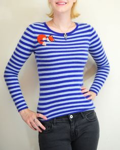 We love this one-of-a-kind stripped sleeping fox top by Re:awakened. Available in size XS. ($68)