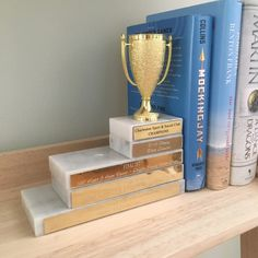 It's been almost 2 years since I started my sports display project (?) and I realized I never finished one of the projects. I talked about repurposing old trophies, but just left some tro… Sports Room, Bookends, Trophies And Medals, Trophy Display, Trophy Craft, Recycling, Display, Old Trophies, Award Display