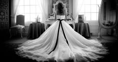 Back of bride with large wedding dress train - Picture byJohn Alexander Photography