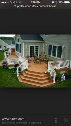 Dream deck!!! Change to black railing, wood newel posts, carriage lights on front and corner posts. Love the shape. Love the size. Want!!