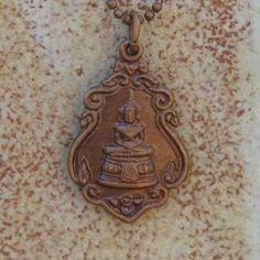 Thai Buddha Necklace, Thai Amulet Buddha Necklace, Dual Sided Pendant, Yoga Gift, Yoga Jewelry. $22.00, via Etsy. For centuries, the monks have been crafting these wonderful little treasures in Buddhist temples. Each amulet is blessed by a Thai monk and greatly prized in Thailand.