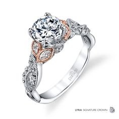 Fancy marquise diamonds wrapped is Rose Gold and sparkling twists of white diamonds showcase a brilliant center stone.