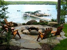Love this idea. Make flagstone patio area larger and use stacked stone for building the firepit instead of these big stones. More landscaping around the flagstones. This looks so peaceful and relaxing!