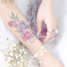 Roses on forearm by Mini Lau on We Heart It