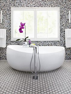 We love this busily tiled bathroom and the excellent egg-shaped tub! More contemporary bathroom ideas: http://www.bhg.com/bathroom/decorating/modern/contemporary-tiled-bath/?socsrc=bhgpin092813contemporarybathroom&page=1