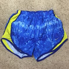 Limited edition blue and yellow Nike shorts These are limited edition Nike running shorts in blue tye dye with yellow accents. Fantastic condition! Wore them once! Nike Shorts