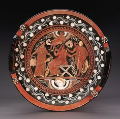 AN APULIAN RED FIGURE KNOB-HANDLED PATERA   attributed to the baltimore painter  circa 330-320 b.c.